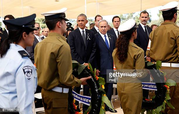 S President Barack Obama and Israeli Prime Minister Benjamin Netanyahu look on as Israeli military pass by with wreaths of flowers during the funeral...