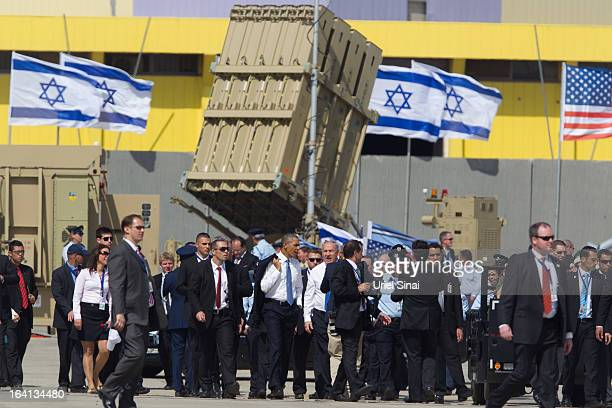 President Barack Obama and Israel's Prime Minister Benjamin Netanyahu walk away after visiting an Iron Dome missile battery at the Ben Gurion Airport...