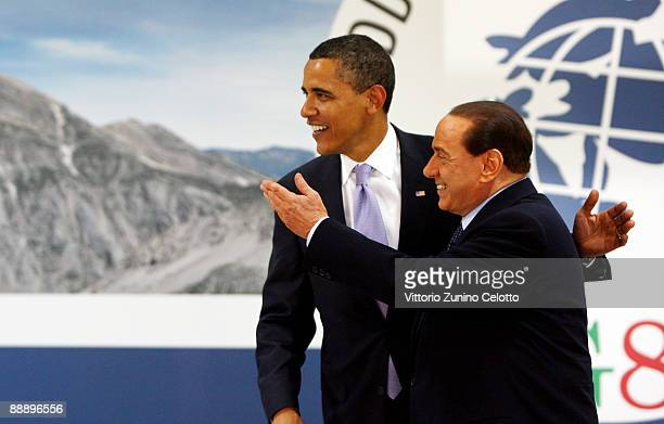 President Barack Obama and Italian Prime Minister Silvio Berlusconi greet one another at the Guardia Di Finanza School of Coppito on July 8, 2009 in...