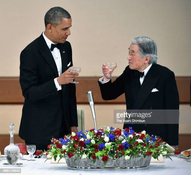 US President Barack Obama and Japanese Emperor Akihito toast their glasses during the official state dinner at the Imperial Palace on April 24 2014...