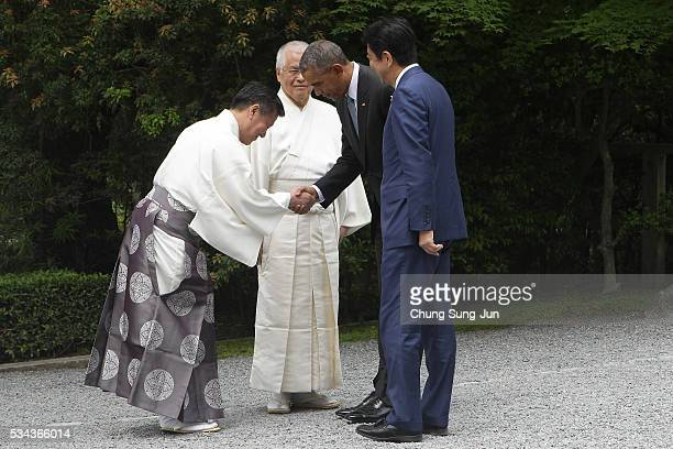 S President Barack Obama and Japanese Prime Minister Shinzo Abe are greeted by Shinto priests as they visit the IseJingu Shrine on May 26 2016 in Ise...