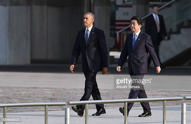 S President Barack Obama and Japanese Prime Minister Shinzo Abe arrive at the Hiroshima Peace Memorial Park on May 27 2016 in Hiroshima Japan It is...