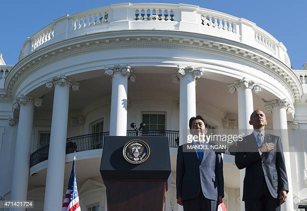 US President Barack Obama and Japanese Prime Minister Shinzo Abe attend an arrival ceremony for an official visit on the South Lawn of the White...