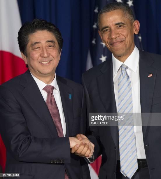 President Barack Obama and Japanese Prime Minister Shinzo Abe shake hands prior to holding a bilateral meeting on the sidelines of the Asia-Pacific...