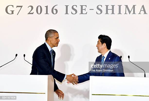 US President Barack Obama and Japanese Prime Minister Shinzo Abe shake hands after a joint press conference following their bilateral meeting ahead...