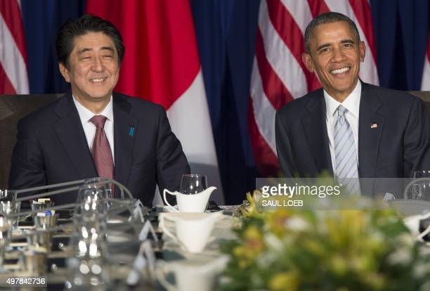 President Barack Obama and Japanese Prime Minister Shinzo Abe smile during their bilateral meeting on the sidelines of the Asia-Pacific Economic...