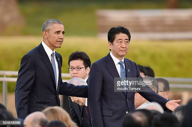 S President Barack Obama and Japanese Prime Minister Shinzo Abe visit the Hiroshima Peace Memorial Park on May 27 2016 in Hiroshima Japan It is the...
