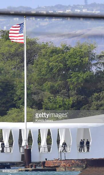 US President Barack Obama and Japanese Prime Minister Shinzo Abe visit the USS Arizona Memorial at Pearl Harbor in Hawaii on Dec 27 to commemorate...