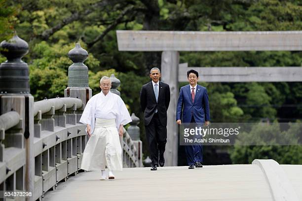 President Barack Obama and Japanese Prime Minister Shinzo Abe walk the Ujibashi Bridge as they visit Ise Jingu Shrine ahead of the Group of Seven...