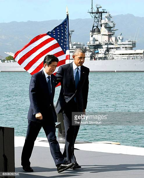 US President Barack Obama and Japanese Prime Minister Shinzo Abe walk to greet Pearl Harbor survivors at Joint Base Pearl Harbor Hickam's Kilo Pier...