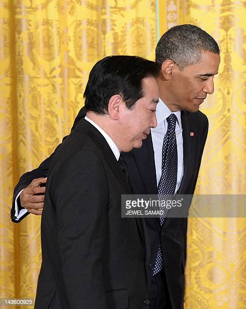 US President Barack Obama and Japan's Prime Minister Yoshihiko Noda leave after a joint press conference in the East Room at the White House in...