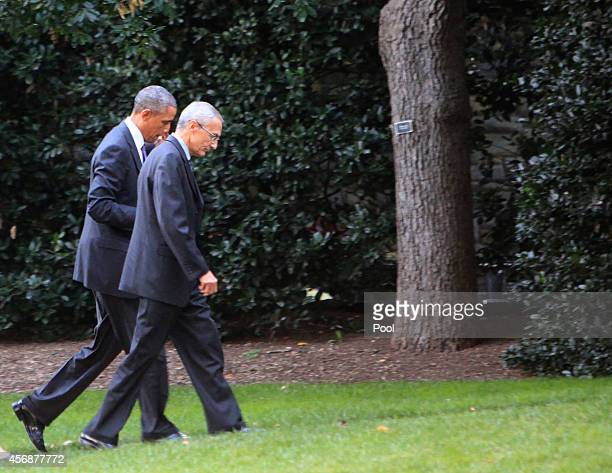 S President Barack Obama and John Podesta counselor to the president walk to the Oval Office after returning from a meeting at the Pentagon on...