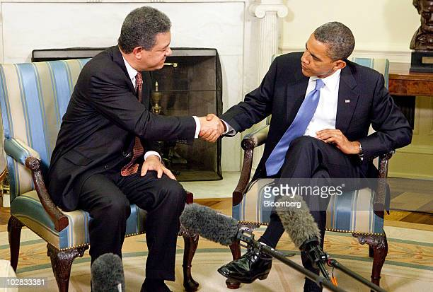 US President Barack Obama and Leonel Fernandez president of the Dominican Republic shake hands after a bilateral meeting in the Oval Office of the...