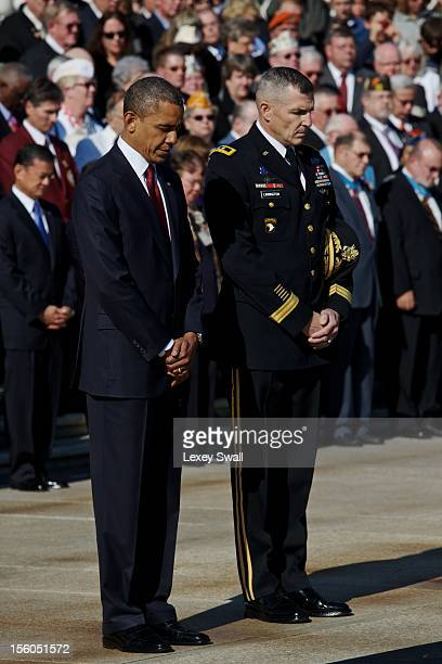 S President Barack Obama and Major General Michael S Linnington bow their heads as Taps is played during the Presidential WreathLaying Ceremony at...