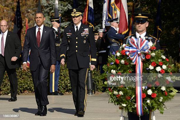 S President Barack Obama and Major General Michael S Linnington Commander of the US Army Military District of Washington participate in a...
