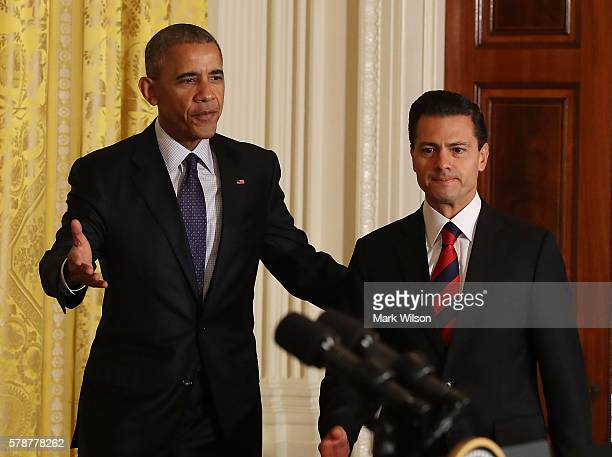 S President Barack Obama and Mexican President Enrique Pena Nieto arrive to speak to the media during a news conference in the East Room at the White...