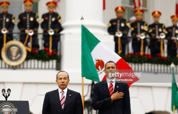 S President Barack Obama and Mexican President Felipe Calderon stand for their countries' national anthems during a welcoming ceremony on the South...
