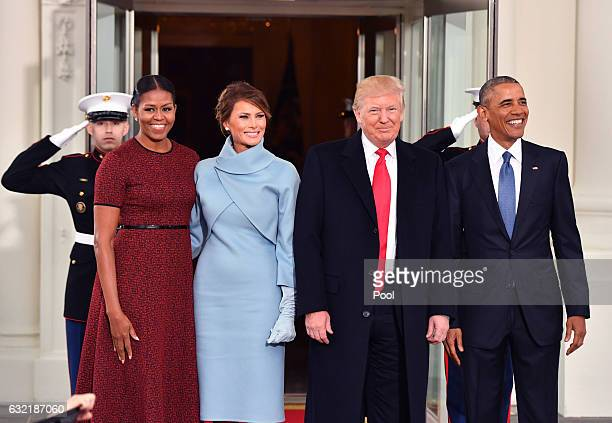 President Barack Obama and Michelle Obama pose with Presidentelect Donald Trump and wife Melania at the White House before the inauguration on...