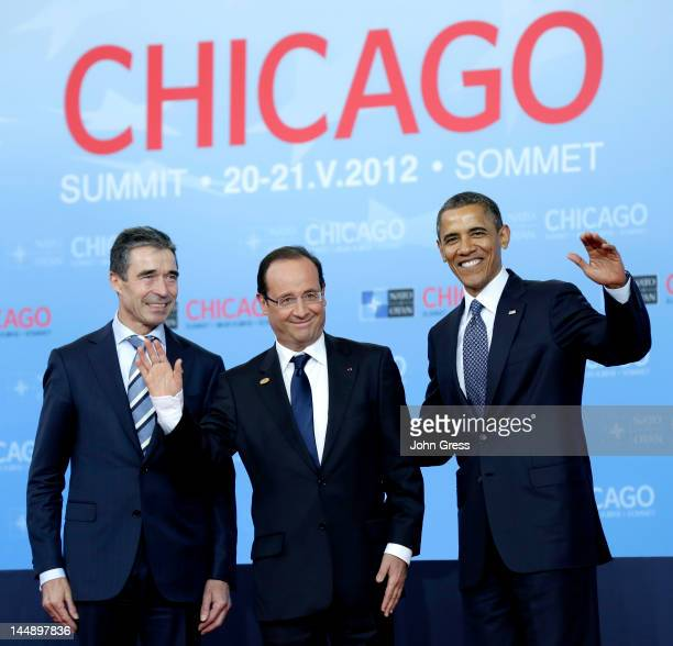 S President Barack Obama and NATO Secretary General Anders Fogh Rasmussen greet French President Francois Hollande as he arrives at the NATO summit...