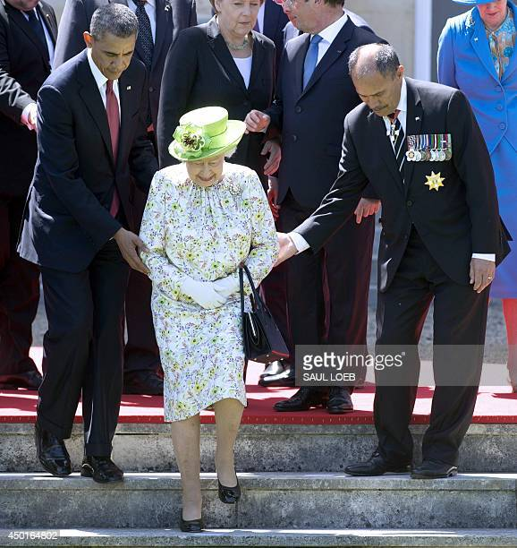 US President Barack Obama and New Zealand GovernorGeneral Jerry Mateparae help Queen Elizabeth II to her position during a group photo of world...