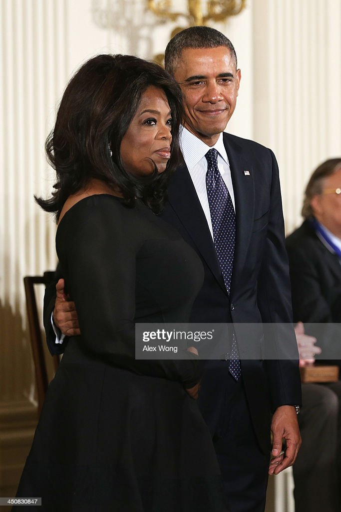 U.S. President Barack Obama (R) and Oprah Winfrey (L) on stage before Winfrey receives the Presidential Medal of Freedom in the East Room at the White House on November 20, 2013 in Washington, DC. The Presidential Medal of Freedom is the nation's highest civilian honor, presented to individuals who have made meritorious contributions to the security or national interests of the United States, to world peace, or to cultural or other significant public or private endeavors.