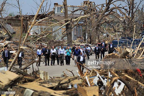 US President Barack Obama and other officials tour the community that was devastated a week ago by a tornado on May 29 2011 in Joplin Missouri The...
