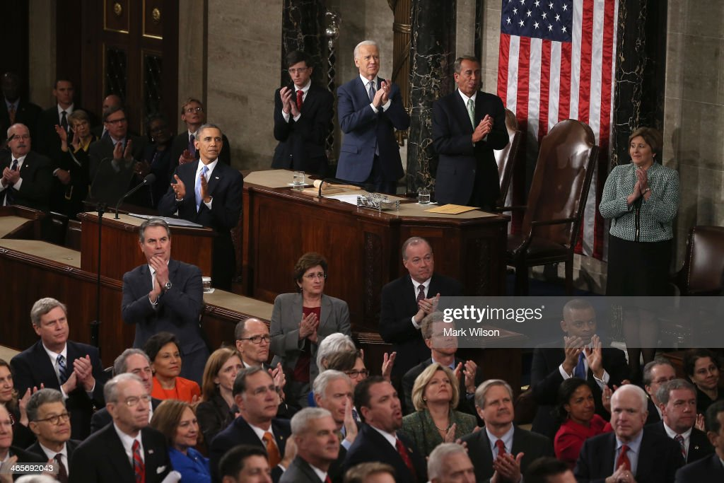 U.S. President Barack Obama and others applaud for US Army Ranger Sergeant First Class Cory Remsburg as he is acknowledged during the State of the Union address to a joint session of Congress in the House Chamber at the U.S. Capitol on January 28, 2014 in Washington, DC. In his fifth State of the Union address, Obama is expected to emphasize on healthcare, economic fairness and new initiatives designed to stimulate the U.S. economy with bipartisan cooperation.