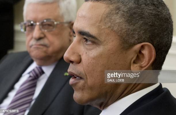 US President Barack Obama and Palestinian President Mahmud Abbas during meetings in the Oval Office of the White House in Washington DC March 17 2014...