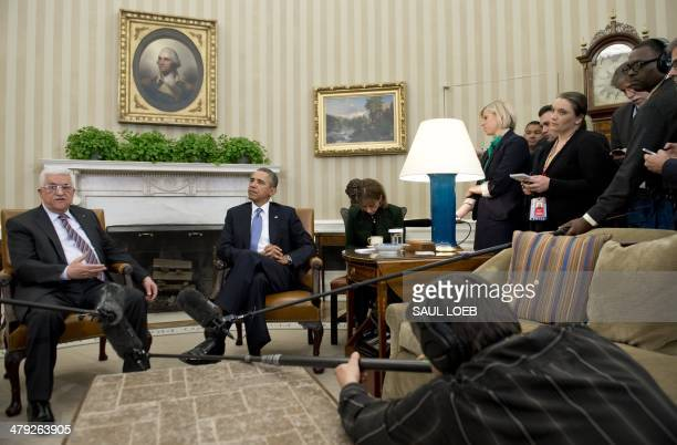 US President Barack Obama and Palestinian President Mahmud Abbas hold meetings in the Oval Office of the White House in Washington DC March 17 2014...