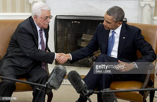 US President Barack Obama and Palestinian President Mahmud Abbas shake hands during meetings in the Oval Office of the White House in Washington DC...