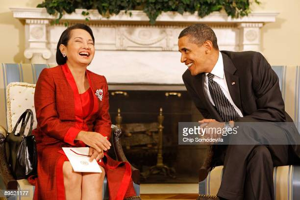 President Barack Obama and Philippine President Gloria Macapagal-Arroyo pose for photographs after a meeting in the Oval Office at the White House...