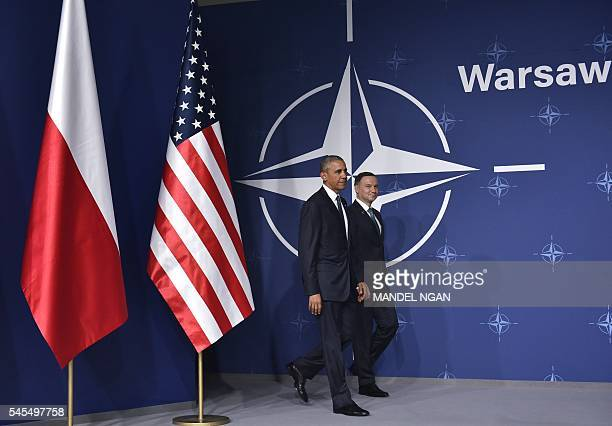 US President Barack Obama and Poland's President Andrzej Duda arrive to deliver a joint press statements following a bilateral meeting on the...