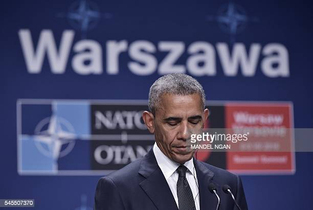 US President Barack Obama and Poland's President Andrzej Duda attend a press conference following a bilateral meeting on the sidelines of the NATO...