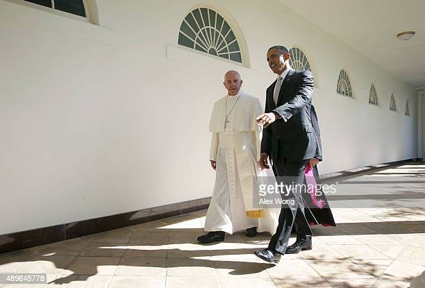 S President Barack Obama and Pope Francis walk through the colonnade prior to an Oval Office meeting at the White House on September 23 2015 in...