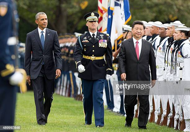 President Barack Obama and President XI Jinping of China participate in an arrival ceremony during an official State Visit on the south lawn of the...