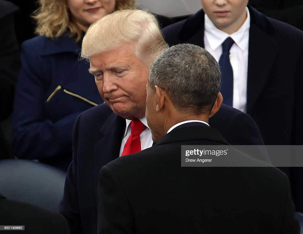 U.S. President Barack Obama (R)) and President-elect Donald Trump speak on the West Front of the U.S. Capitol on January 20, 2017 in Washington, DC. In today's inauguration ceremony Donald J. Trump becomes the 45th president of the United States.