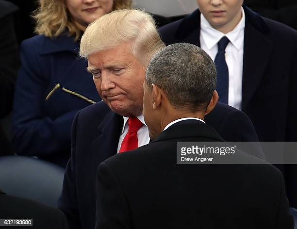 S President Barack Obama and Presidentelect Donald Trump speak on the West Front of the US Capitol on January 20 2017 in Washington DC In today's...