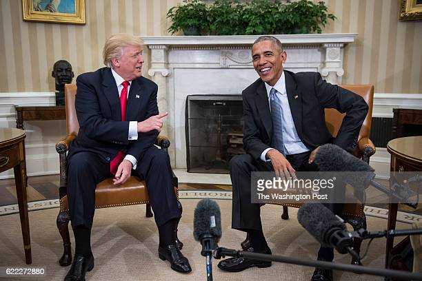 President Barack Obama and Presidentelect Donald Trump talk to members of the media during a meeting in the Oval Office of the White House in...