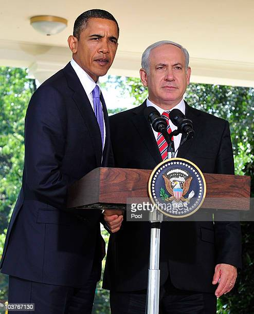President Barack Obama and Prime Minister Benjamin Netanyahu of Israel shake hands after making a statement on the killings in the West Bank after...