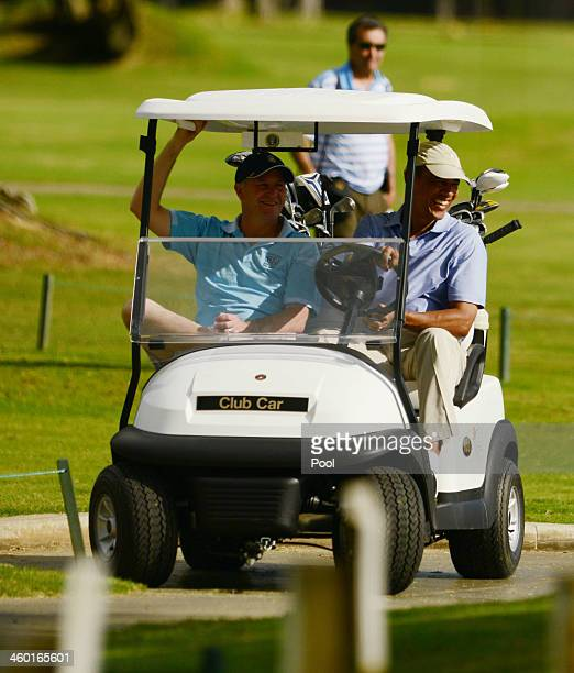 S President Barack Obama and Prime Minister of New Zealand John Key ride in a golf cart while golfing at the Marine Corps Base Hawaii's Kaneohe...