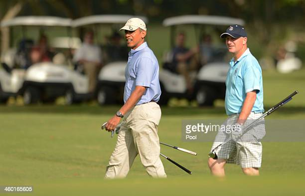 S President Barack Obama and Prime Minister of New Zealand John Key approach the second green while playing golf at the Marine Corps Base Hawaii's...