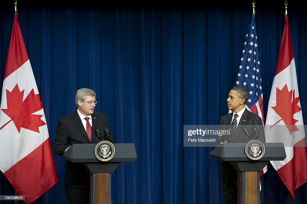 U.S. President Barack Obama (R) and Prime Minister Stephen Harper of Canada participate in a news conference in the South Court Auditorium, next to the White House December 7, 2011 in Washington, DC. The press conference came after a meeting between the two to discuss the countries' bilateral relationship, including economic competitiveness, security, and other global issues.