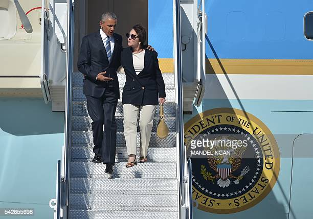 US President Barack Obama and Rep Anna Eshoo step off Air Force One upon arrival at Moffett Federal Airfield in Mountain View California on June 23...