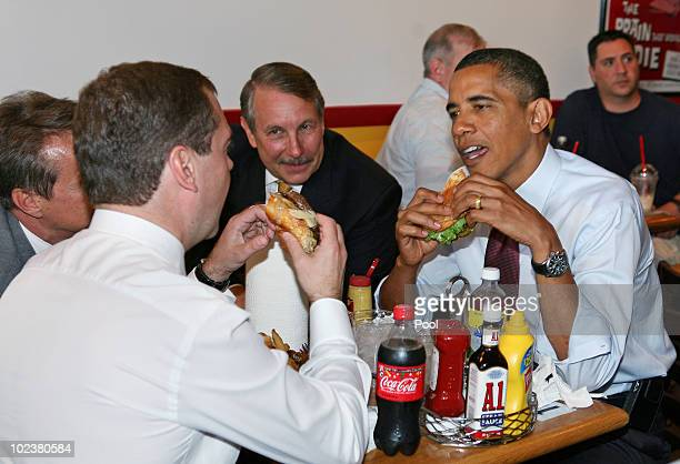 S President Barack Obama and Russian Federation President Dmitry Medvedev eat cheeseburgers at Ray's Hell Burger June 24 2010 in Arlington Virgina...