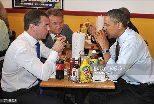 US President Barack Obama and Russian President Dmitry Medvedev eat burgers during a lunch at Ray's Hell Burger June 24 2010 in Arlington Virginia...