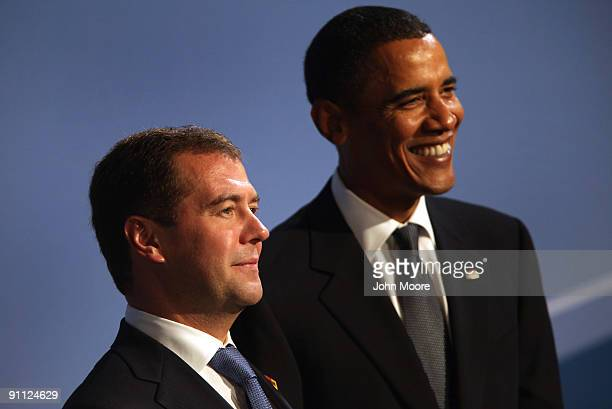 President Barack Obama and Russian President Dmitry Medvedev pose for photos at the Phipps Conservatory for the G20 Summit on September 24 2009 in...