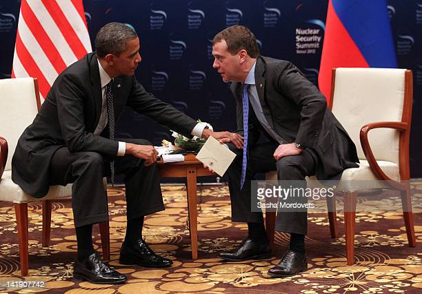 US President Barack Obama and Russian President Dmitry Medvedev talk during the 2012 Seoul Nuclear Security Summit at the Hankuk University of...