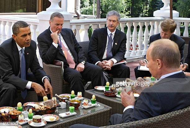 President Barack Obama and Russian Prime Minister Vladimir Putin converse while having traditional Russian tea and snacks on a terrace at Putin's...