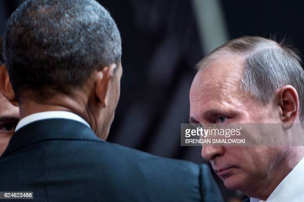 President Barack Obama and Russia's President Vladimir Putin talk before an economic leaders meeting at the AsiaPacific Economic Cooperation Summit...