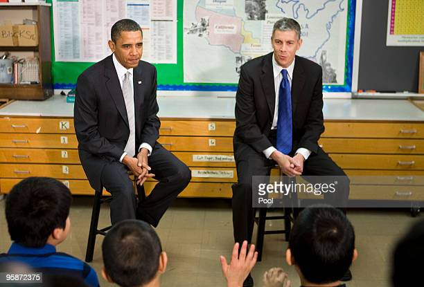 US President Barack Obama and Secretary of Education Arne Duncan visits with sixth grade students at the Graham Road Elementary School January 19...